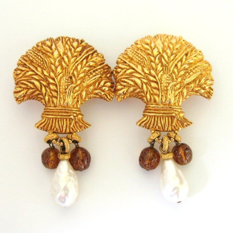 Dominique Aurientis with an Exquisite Large gold tone dangle earrings. They Poured glass and Baroque pearl dangling from a large clip on. This a huge earrings and will make a statement! We have other pieces of her amazing jewelry on our storefront.