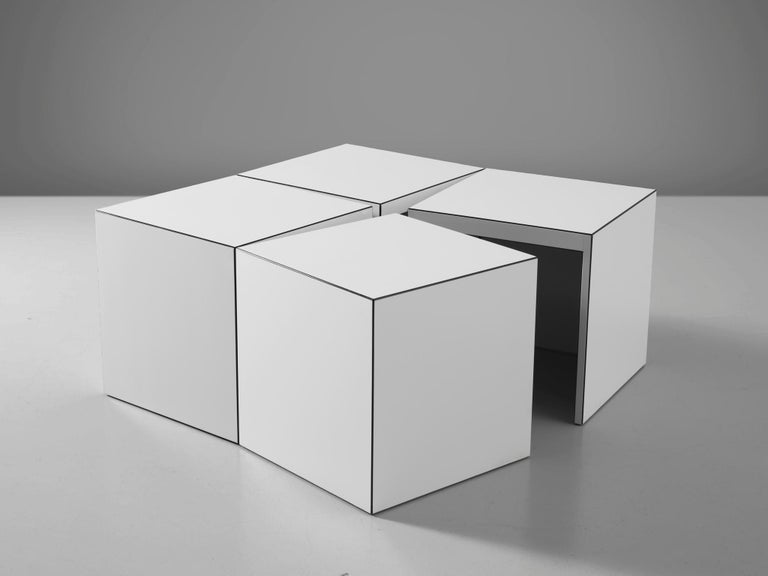 Jan Wichers and Alexander Blomberg for Rosenthal Munich, 'Domino' coffee table, white acrylic on building board, Germany, 1979.  This playful coffee or side table can easily be transformed into several functional shapes. It consists of four