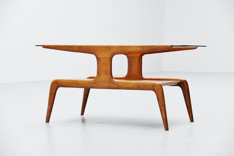Very nice sculptural coffee table designed by Gio Ponti for the store 'La Rinascente', Italy 1950. This table was made of walnut wood and gas a glass top. There is a very nice pattern on the lower part of the table, looks like a diamond. The table