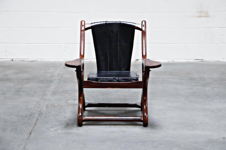 Named the 'Swinger Chair' for its pivoting mechanism that allows you to swing in your seat, this incredible cocobolo rosewood and black leather 'Swinger' rocking armchair by leading 1960s modernist designer Don Shoemaker for Senal S.A. (Mexico) is