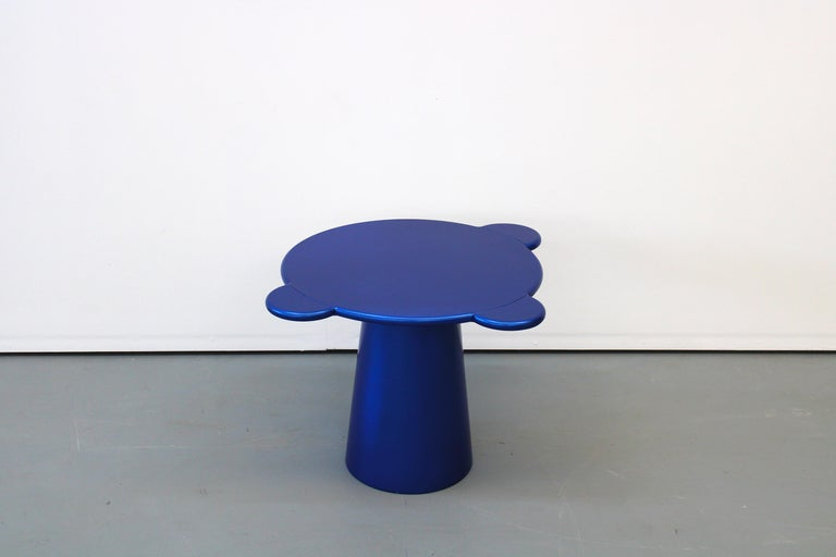 Donald coffee table has a sculptural and a cosmic aspect with colorful and circular shapes. Donald slots into the real space by interacting colors and shapes in an astral dimension. Its name is a tribute to the visual artist Donald Judd for his
