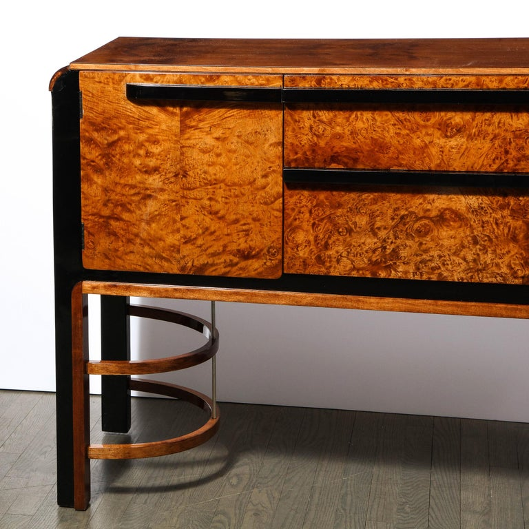 This stunning Art Deco Machine Age sideboard was designed by Donald Deskey (the visionary behind Radio City Music Hall) and realized for the Widdicomb Furniture Company in the United States, circa 1935. It features a burled carpathian elm front with