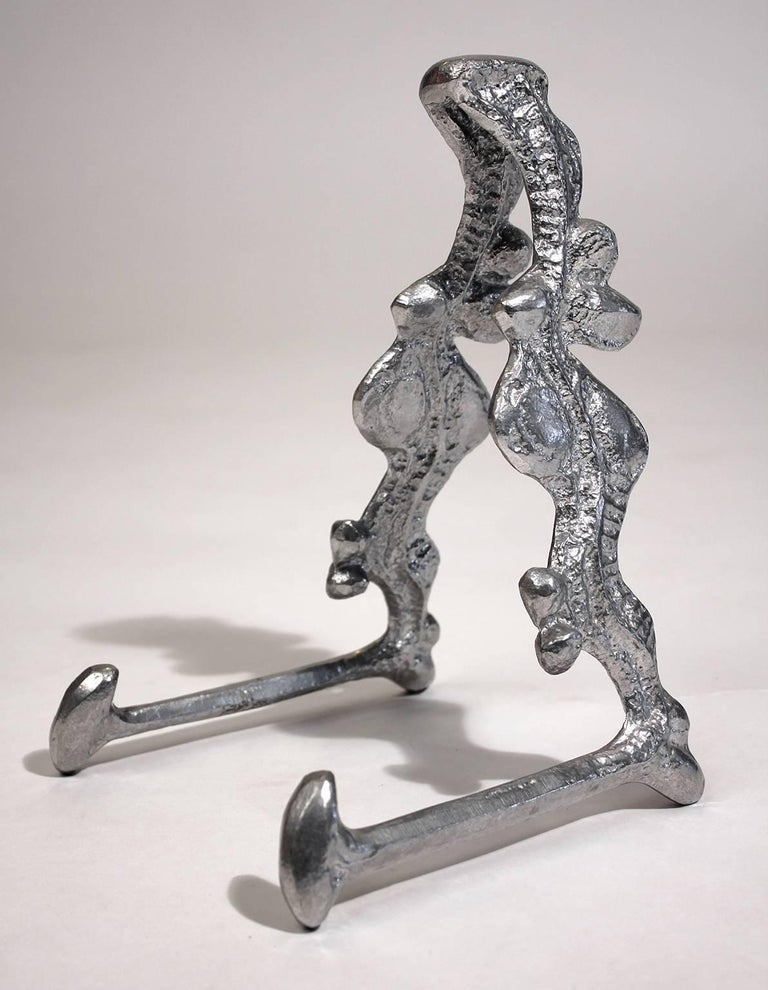 Rare signed Donald Drumm cast aluminium sculptural table easel picture or plate display stand. Great form and can hold many different pieces of art. In excellent shape.