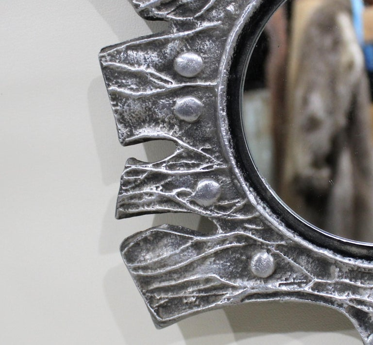 Cast aluminum Mid-Century Modern Brutalist mirror by Donald Drumm.