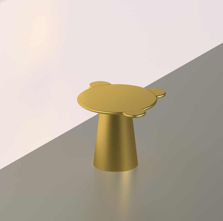 Donald is a multifunctional table with a sculpturally cosmic aspect and colorful circular shapes. The sculptural silhouette has a wooden structure composed of a truncated cone that supports a round top adorned with three semi-circular flaps, ideal