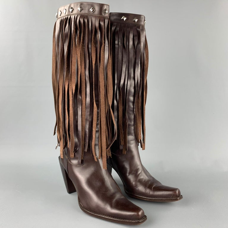 DONALD J PLINER boots comes in a brown leather with stud details featuring a pointed toe, fringe design, wooden sole, chunky heel, and a side zipper closure. Made in Italy.  Very Good Pre-Owned Condition. Marked: 10 M  Measurements:  Length: 9.5
