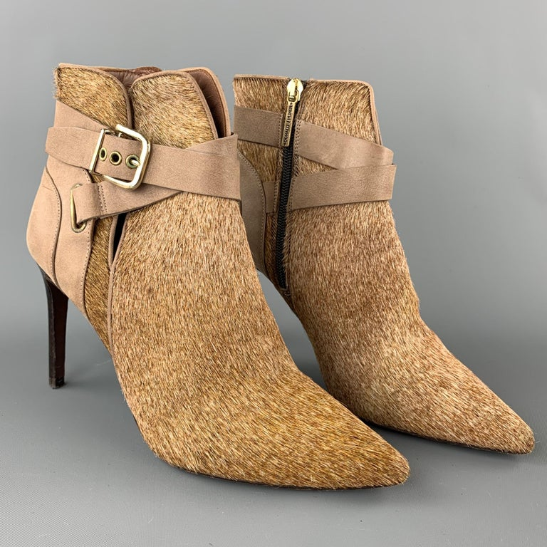DONALD J PLINER ankle boots comes in a tan leather pony hair featuring a buckle detail and a side zipper closure. Made in Spain.  Very Good Pre-Owned Condition. Marked:  Measurements:  Length: 9 in.  Width: 2.5 in.  Heel: 4 in.   SKU: