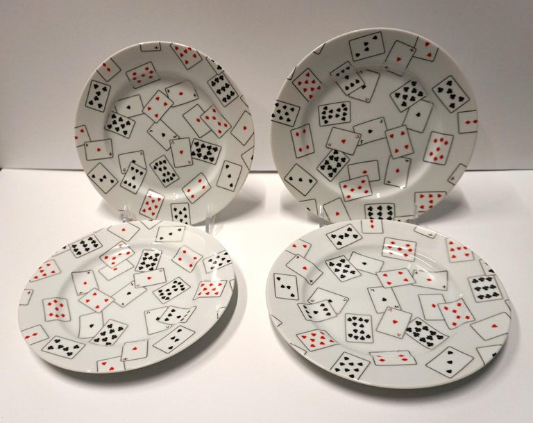 Set of 4 plates and 3 mugs. Made by Swid Powell. Donald Sultan design titled