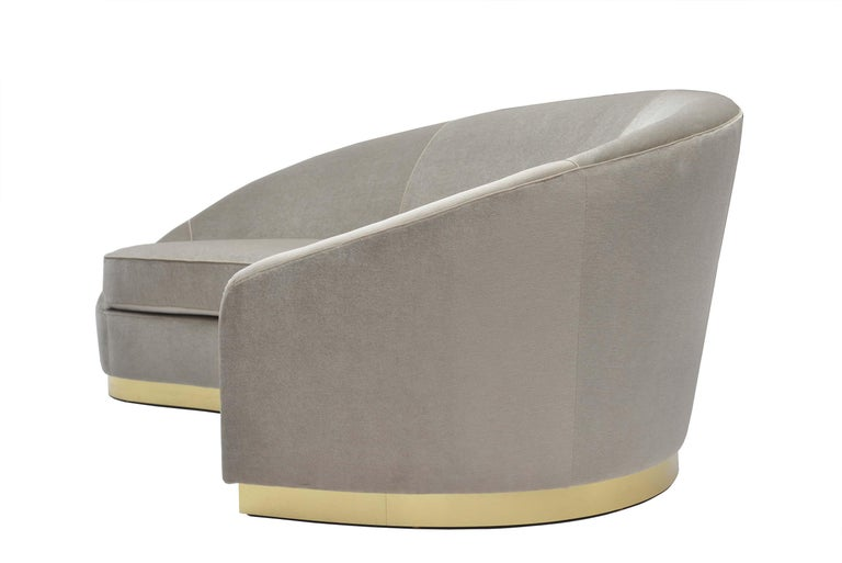 Upholstered sofa with tight back and loose non-reversible bench cushion on a plinth base. Comes standard with welt along the back, down the front arms, on the seat cushion, and at the seam details on the inside back. Available in all standard and