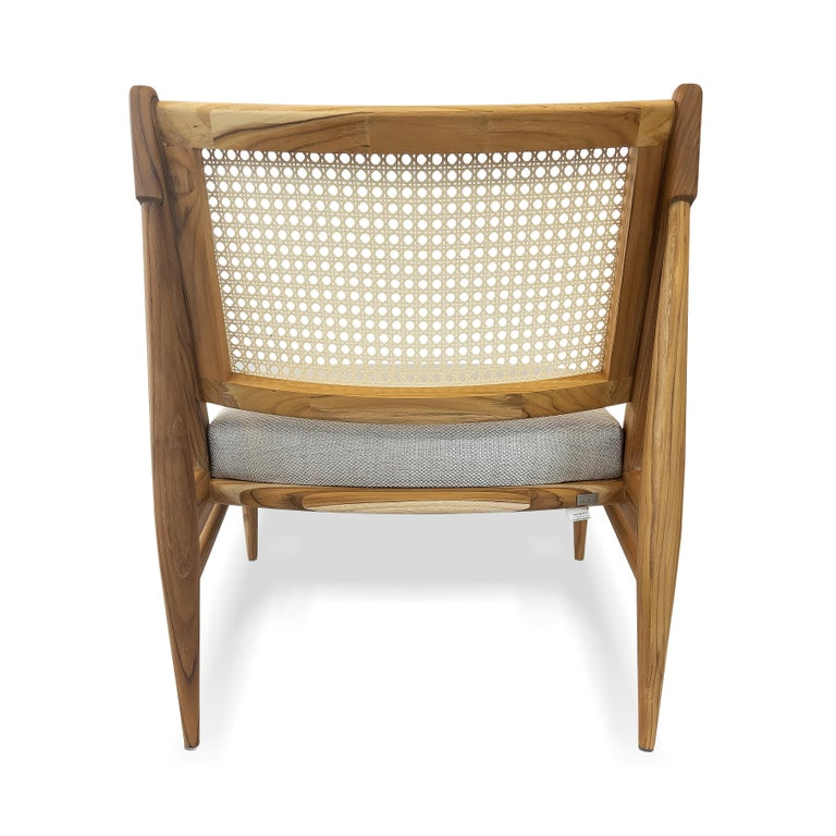 Contemporary Donna Cane-Back Armchair in Teak Finish with Light Fabric Seat For Sale