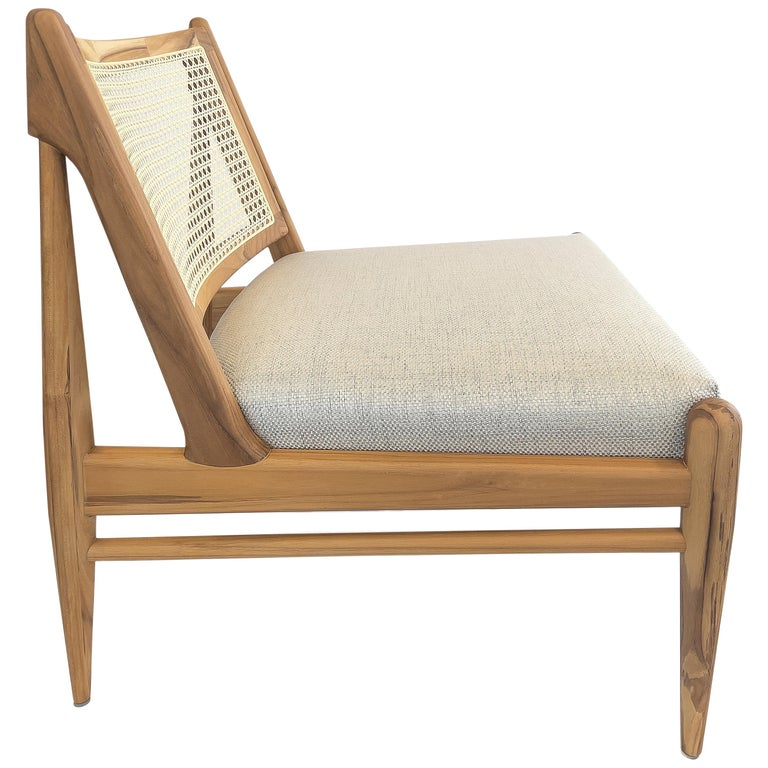 Donna Cane-Back Armchair in Teak Finish with Light Fabric Seat For Sale
