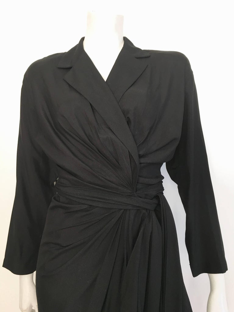 Donna Karan New York 1980s black silk wrap dress is labeled a size 10 but fits like a size 8.  The waist is 31