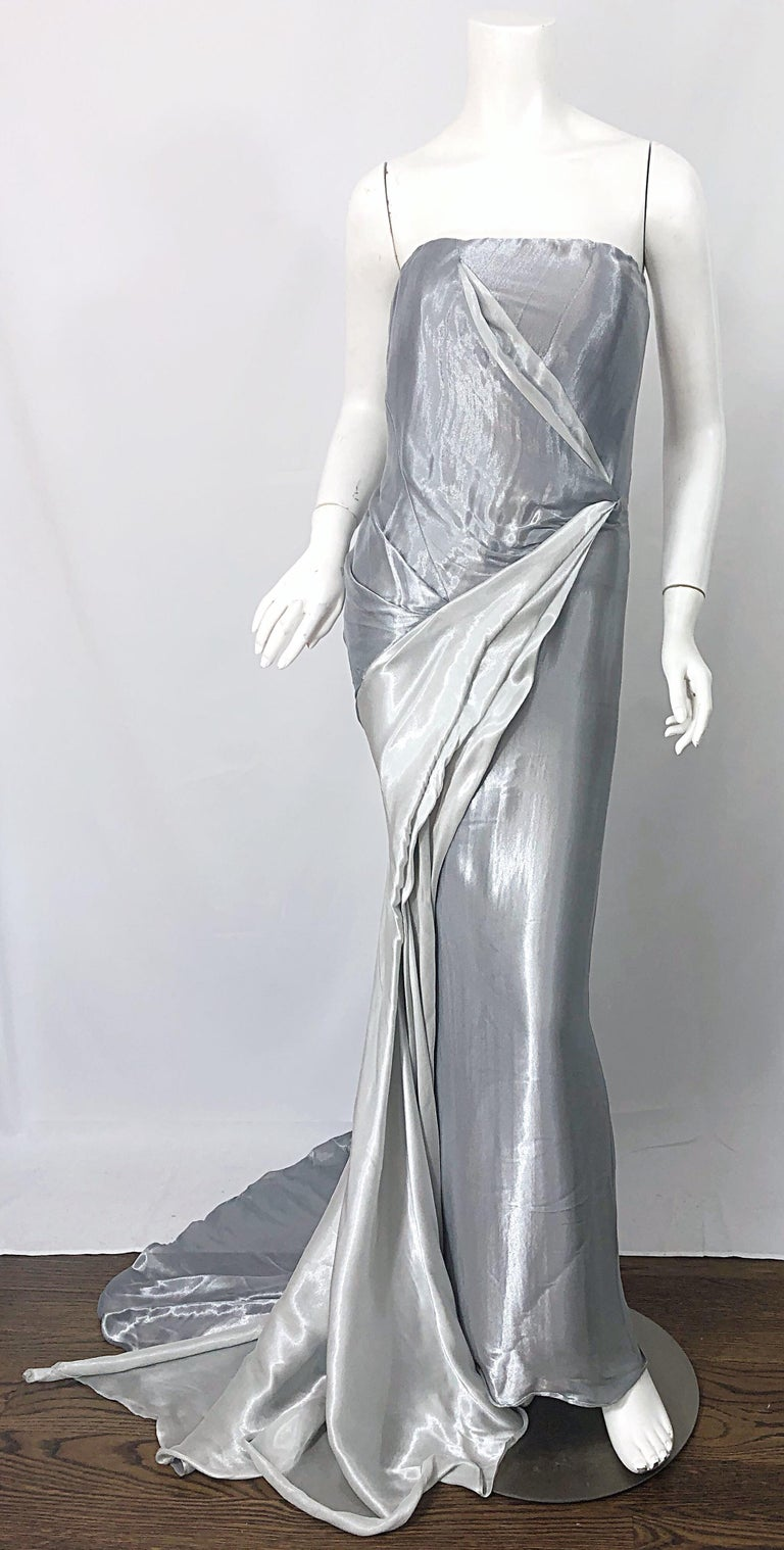 Gorgeous vintage DONNA KARAN silver metallic strapless Grecian gown! Features a boned fitted bodice, with flattering drapes and gathers throughout. Hidden zipper up the back with hook-and-eye closure. Fantastic long train. The perfect evening dress