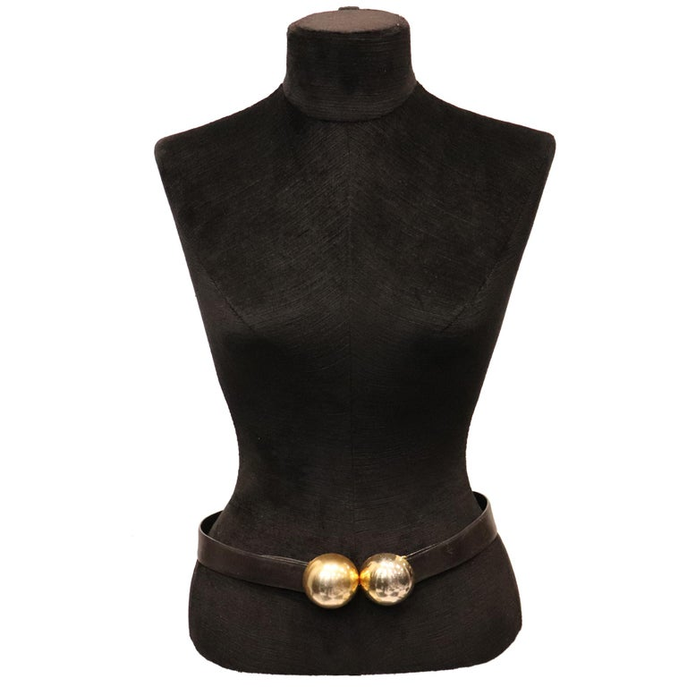 Donna Karan Black Leather Belt W/ 2 Large Gold Balls Closure. From 1990s is in excellent condition   Measurements:   Length - 30 inches Width - 1.3 inches