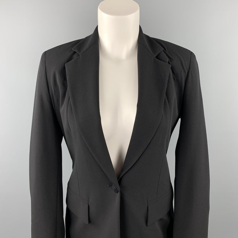 DONNA KARAN blazer comes in a black gabardine wool blend with a full black solid liner featuring a notch lapel, flap pockets, and a single button closure. Made in Italy.   Very Good Pre-Owned Condition. Marked: US 2 / IT 38 / FR