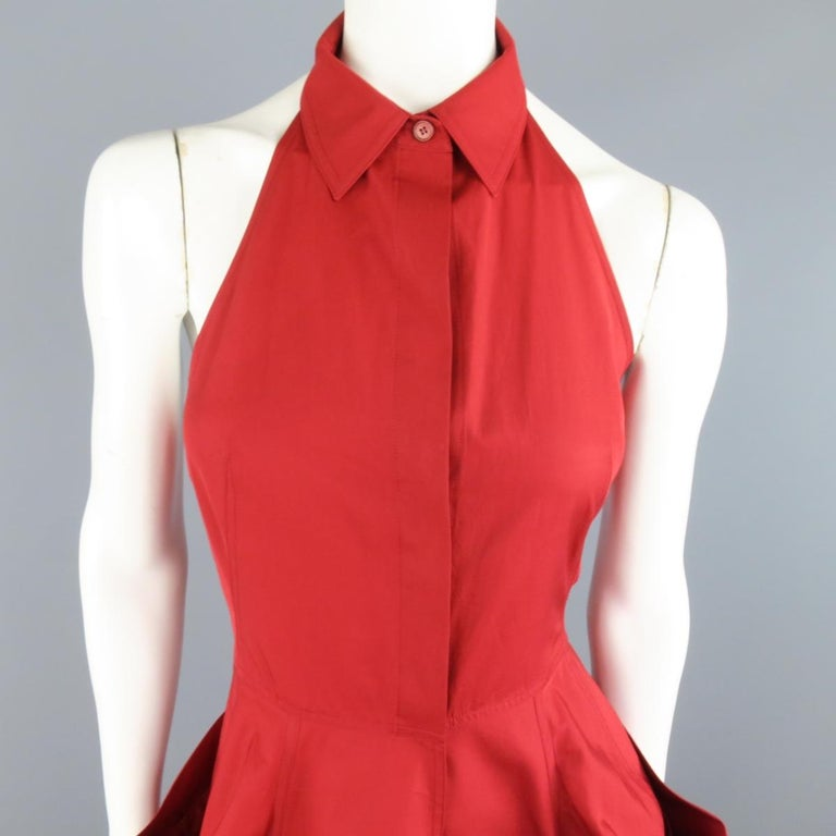 DONNA KARAN shirt dress in a red cotton featuring a hidden placket button and snap front, halter neckline with classic pointed collar, and full A-line skirt with draped panel pockets. Discolorations throughout. As-Is.  Good Pre-Owned