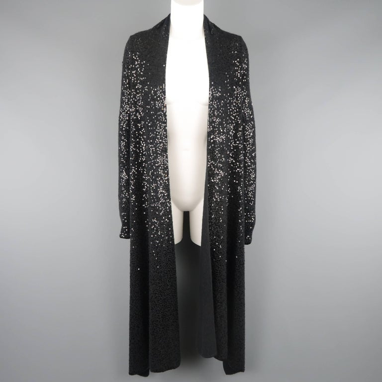 DONNA KARAN Black Label cardigan comes in black sequined cashmere silk blend knit with an open front, extended draped collar, and short back.   Good Pre-Owned Condition. Marked: S   Measurements:   Shoulder: 16 in. Bust: 38 in. Sleeve: 22