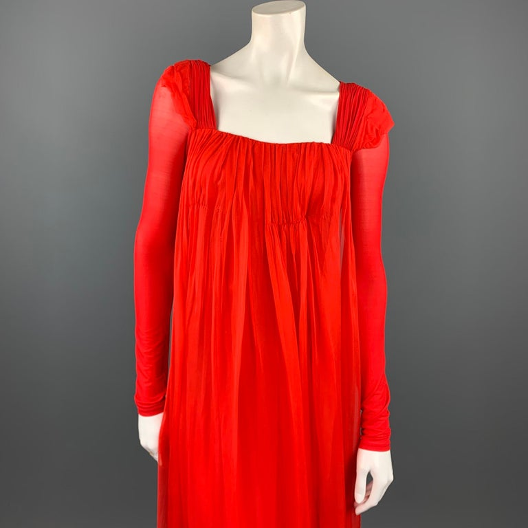 DONNA KARA evening gown comes in a red cupro blend featuring a silk overlay detail, padded shoulders, elastic waistband, and a ruched back design. As-Is. Made in Italy.  Good Pre-Owned Condition. Marked: No size marked  Measurements:  Shoulder: 16.5