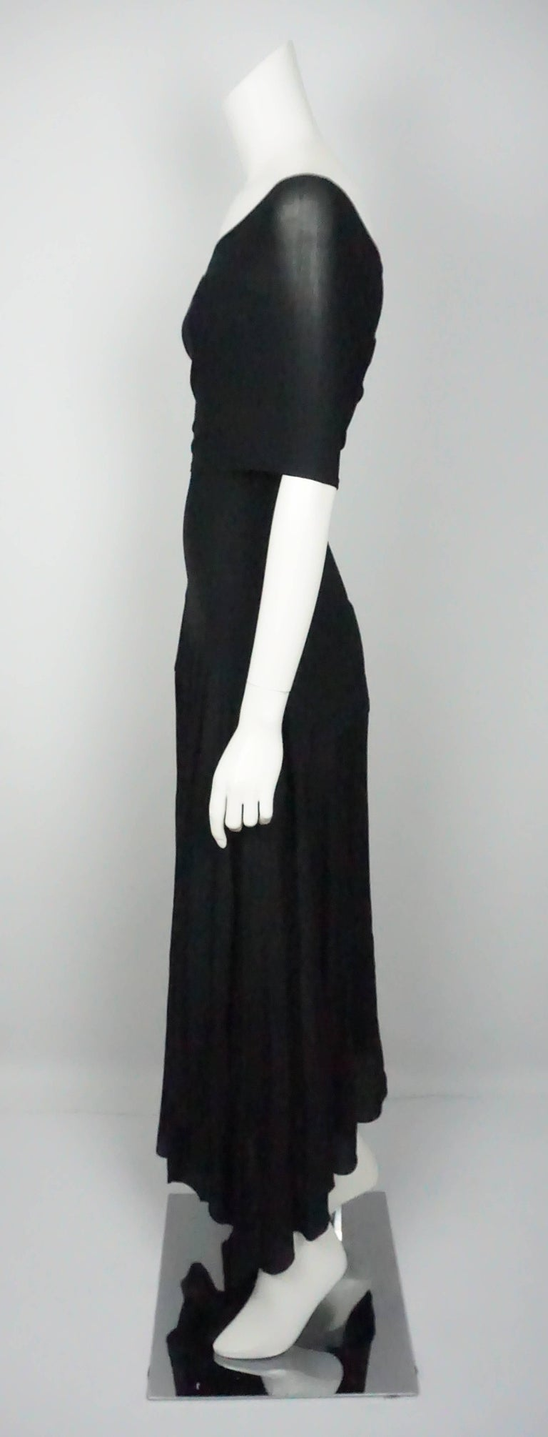Donna Karan Vintage Black Jersey One Shoulder Dress - Small  This spin on the classic black dress is in excellent condition. The dress is made up of a jersey material and is form fitting until it hits the hips. There is an elastic band sewn in at