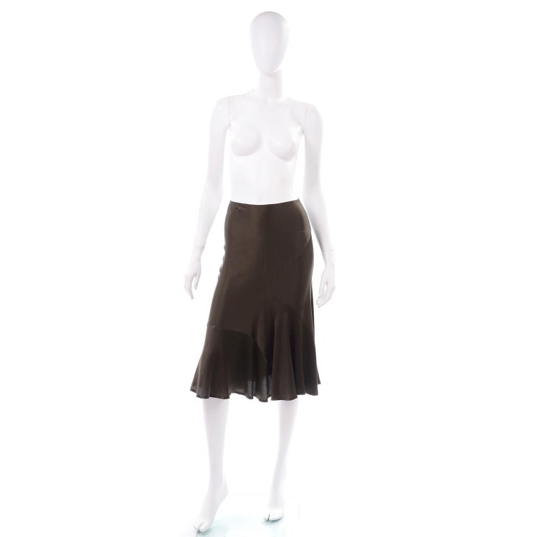 This is a beautiful vintage Donna Karan brownish olive green silk bias cut skirt. This slip style Donna Karan black label skirt can be worn during the day or evening! This skirt has really unique asymmetrical seams all throughout that add some