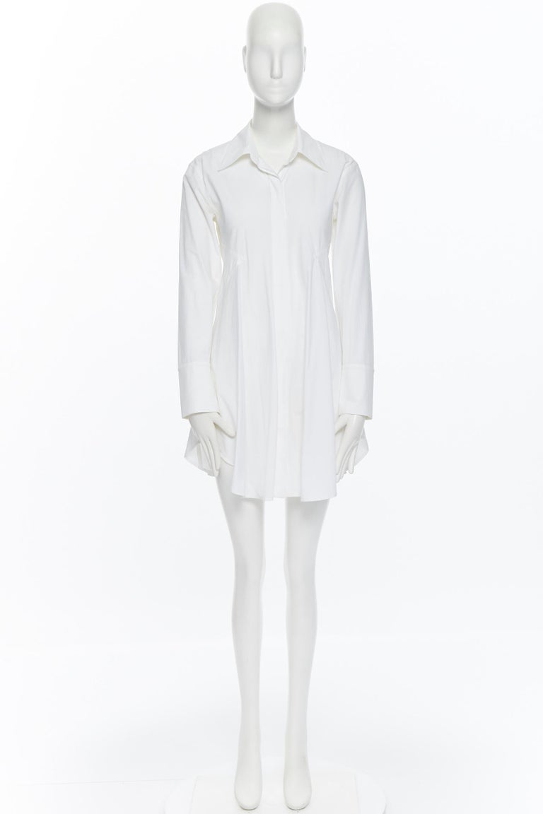 DONNA KARAN white cotton blend angular dart slit pocket mini shirt dress US2 Brand: Donna Karan Designer: Donna Karan Model Name / Style: Shirt dress Material: Cotton blend Color: White Pattern: Solid Closure: Button Extra Detail: Dual side slit