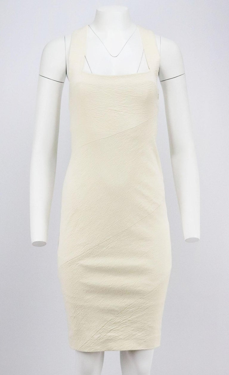 This dress by Donna Karan New York is made from stretch linen-blend - it fits closely to the body and is designed for a bodycon fit that fall just above the knee and has a cross-over back. Cream linen-blend. Concealed zip fastening at side. 64%