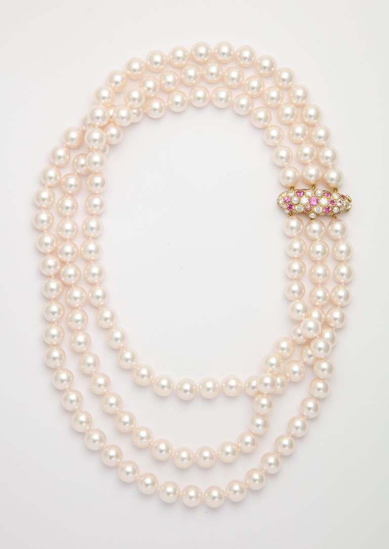 What may have started with Breakfast at Tiffany's is still hot with today's sophisticated woman. This iconic pearl collar is made even more feminine by the use of a handmade custom-designed clasp to play off the rich pinkish hue of the white