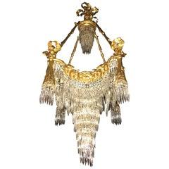 Doré Bronze Louis XVI Style Crystal Ribbon Tassel Drapery Chandelier