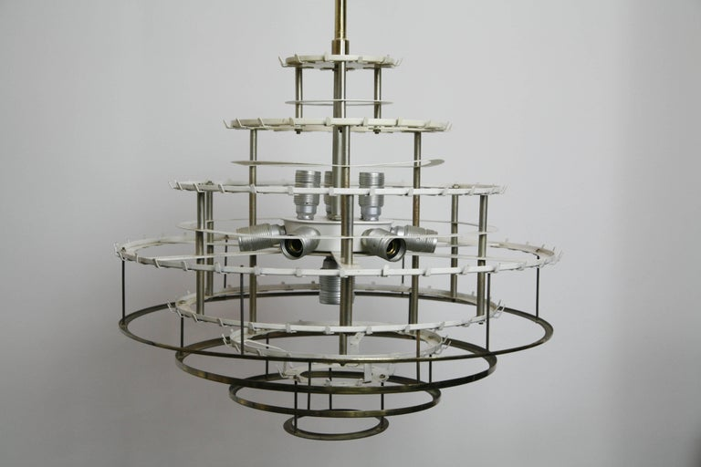 Large Doria glass tube chandelier from the 1960s Germany, a white metal frame that has an addition of the lowest four tier of brass rings that are underlying the glass tubes and supporting them gives a warm glow to the light, with 260 glass tubes