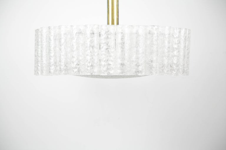 Doria glass tube chandelier from the 1960s, Germany, a metal frame with 32 frosted glass tubes a frosted glass diffuser surrounded by a high polished brass disc with beautiful patina, all original with manufacturer sticker. Six sockets.
