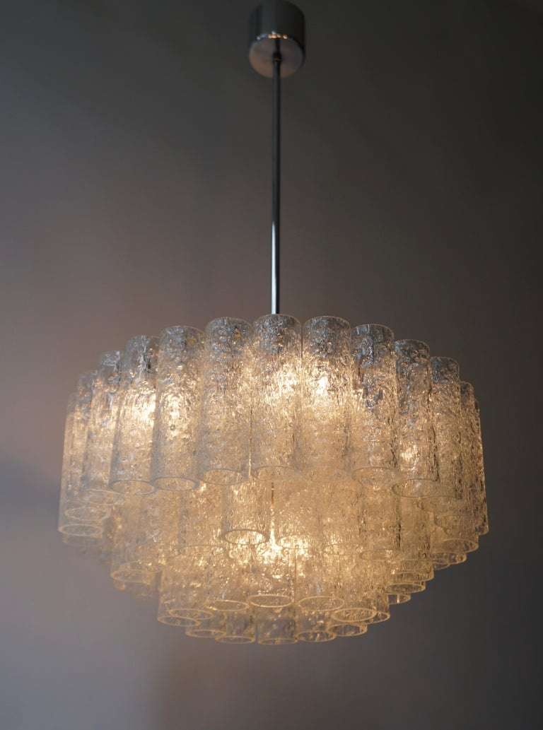 1960s chandelier by Doria, Germany. Three tiers of 60 textured glass tubes on brass and white frame. 