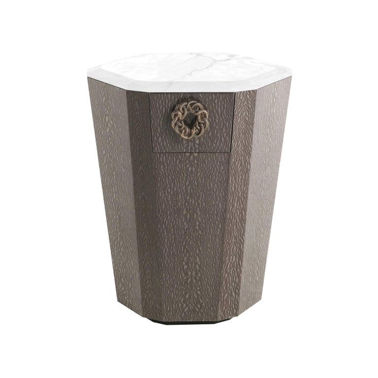 """Night table. Structure in multi-layer wood. Finishing in wooden finishing glossy carbalho rose colour. Top in marble CAT. A Bianco Carrara. """"Jewel handles"""" in cast brass available in golden finishing."""