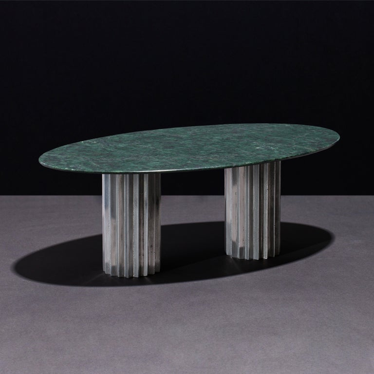 Dining tables with marble tops and multifaceted pedestals in cast bronze, blackened bronze or aluminum.   Inspired by Doric columns in archaic architecture, the extruded multi-point star pedestals have a different finish on each vertical face: the