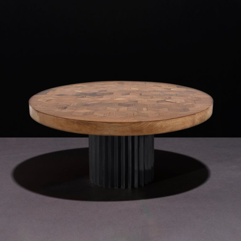 Dining or entrance table with marquetry top in reclaimed oak and multifaceted pedestal in cast blackened bronze.   The marquetry tabletop in reclaimed Oak contains 222 rhombi cut from old Italian wine barrels. Inspired by Doric columns in archaic