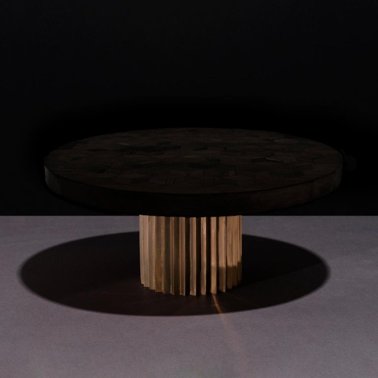 Dining table with ebonized marquetry oak top and multifaceted pedestals in cast bronze. 