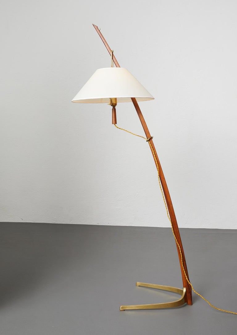 Elegant floor lamp in teak and massive brass called