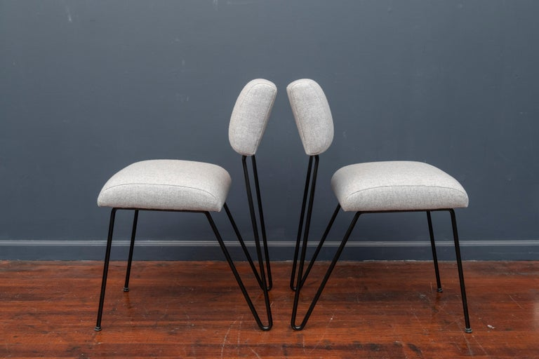 Pair of Dorothy Schindele design side chairs for modern color, Inc. Newly painted flat black frames with new cushions in a light grey felt.
