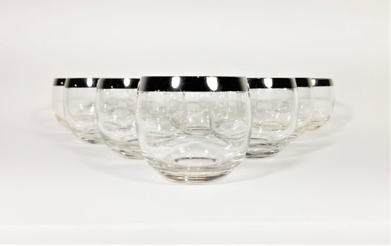 1960s midcentury Dorothy Thorpe silver rimmed glassware barware set of 10. Often referred to as Roly Poly glasses due to there round modern design. An excellent addition to any table, home bar or bar cart.