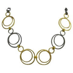 Double Circle Necklace in 22k Gold and Blackened Silver