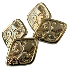 A Pair of Double Diamond Shaped Cufflinks with Raised Design