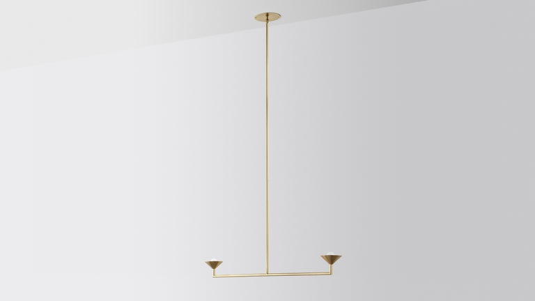 Double drop by Volker Haug Pyramid scheme series Dimensions: W 90.5, D 15 H 70 cm Support: 15 cm Suspension: min 70 cm Material: Brass Finishes: Polished, brushed or bronzed brass, enamel or chrome-plated. Custom finishes available on
