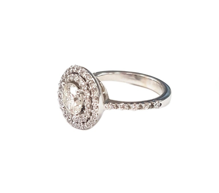 Contemporary Double Halo Diamond and 18 Karat White Gold Ring For Sale