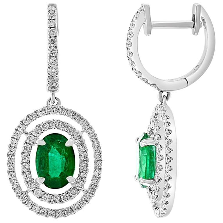 Double Halo Diamond and Emerald Drop Style Earrings, 1.05ct of Emeralds in 18kt For Sale
