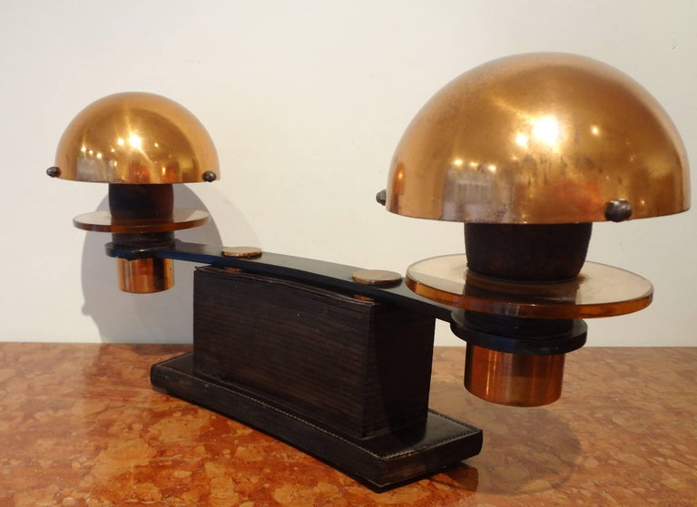 Paul Dupre-Lafon (1900-1971) et Maison Hermes. Rare double leather and wood table lamp, 1930s, by Paul Dupré-Lafon. With two half-spherical brass reflectors, two amber glass disks and leather gained curved base. Signed Hermes. Referenced in