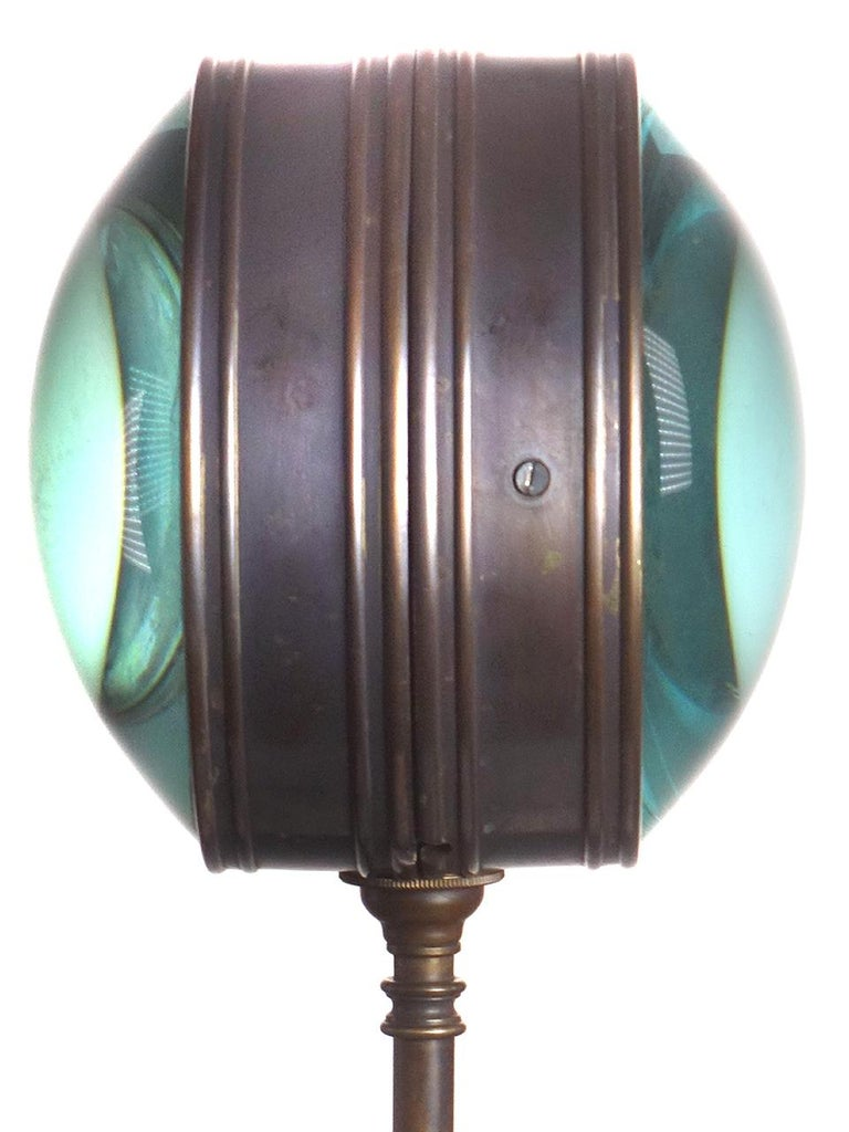 This lamp is totally unique there is nothing out there like it. It takes a single candelabra bulb that looks larger in the thick magnifying glasses. With an antique style filament bulb the look is mesmerizing. Each glass lens is almost 2 inches