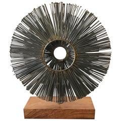 Double Metal Sunburst Sculpture on Wood Base