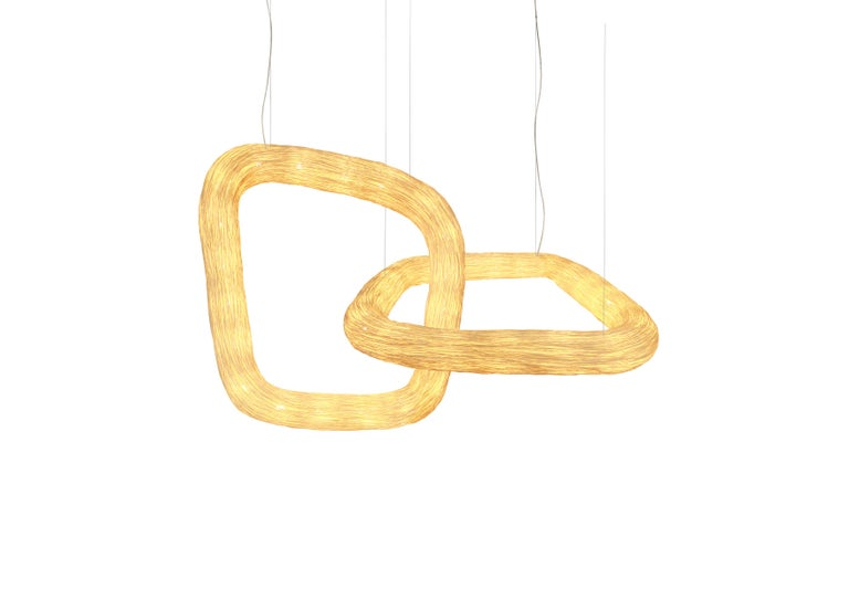 Double Orbit is a unique architectonic rattan ceiling light that is part of the Ango continuity series, where two handcrafted interlocking organic light ring forms reference a double infinity ring and the eternal bond this represents. Multiple