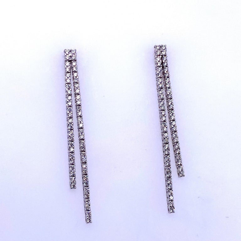 14K White gold drop earrings featuring two diamond rows containing 108 round brilliants weighing 0.90 carats.  Color G Clarity SI2  Available in yellow gold.