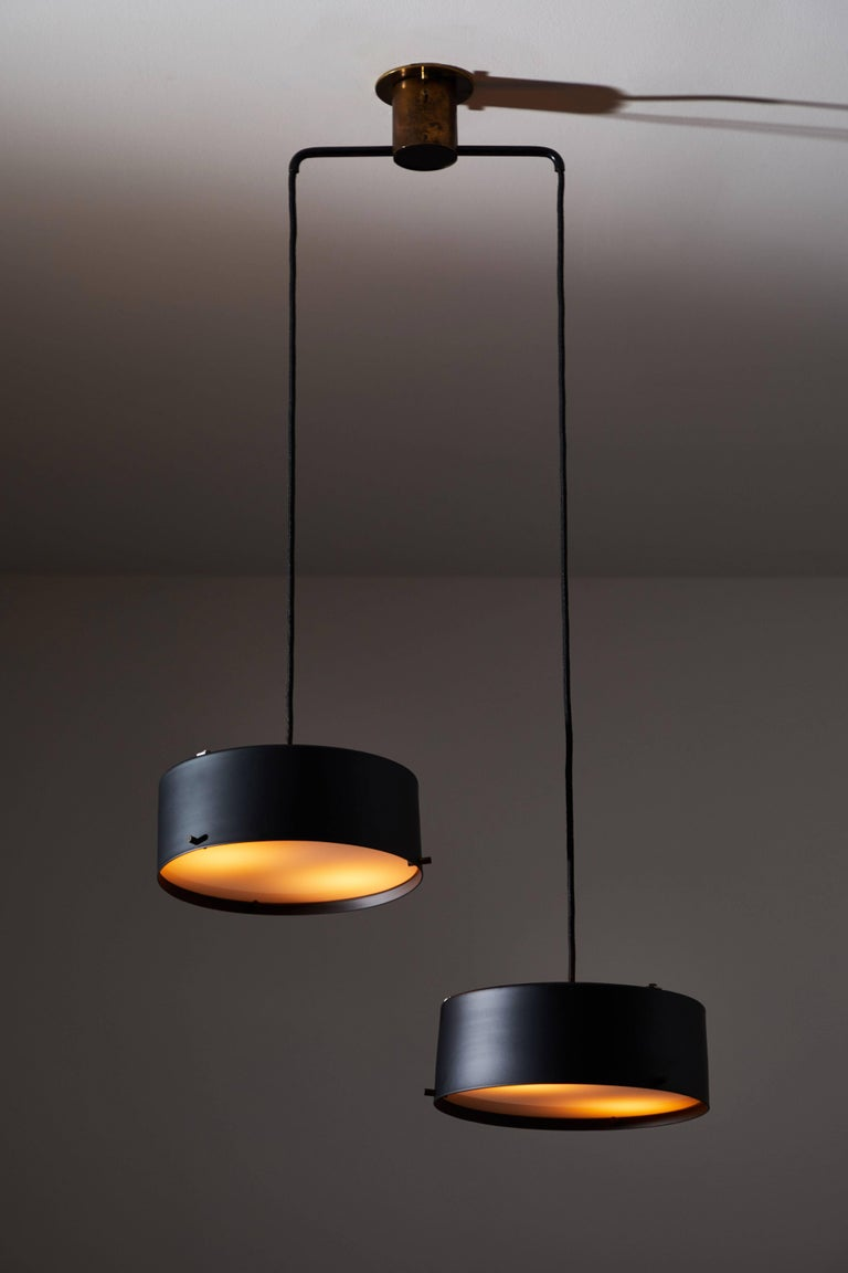 Double shade chandelier by Stilnovo. Designed and manufactured in Italy, circa 1950s. Restored, powder coated metal and glass diffusers. Rewired for US junction boxes. Takes two E27 60w maximum bulbs.