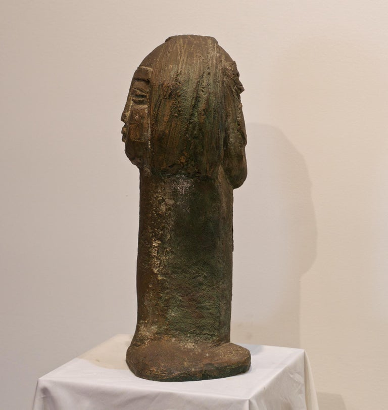 A rustic figural sculpture by Malaysian artist Lim Namg Seng, (b. 1916-d. 1987). The dual sided bust is highly detailed and a gorgeous objet to behold. Seng was regarded as the National Sculpture of Singapore as he performed some of the cities